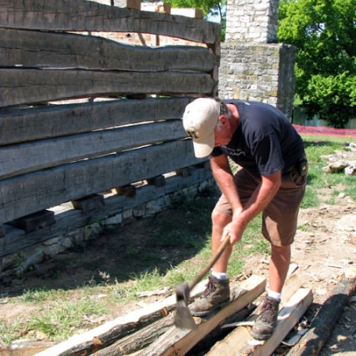 Worker using period tools to built the new Zumwalt's Fort